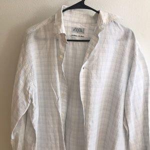 Men's plaid, collared, button up dress shirt.